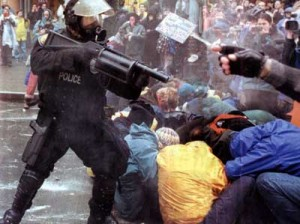 Riot police attacking protestors