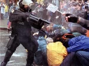 Riot police attacking protestors