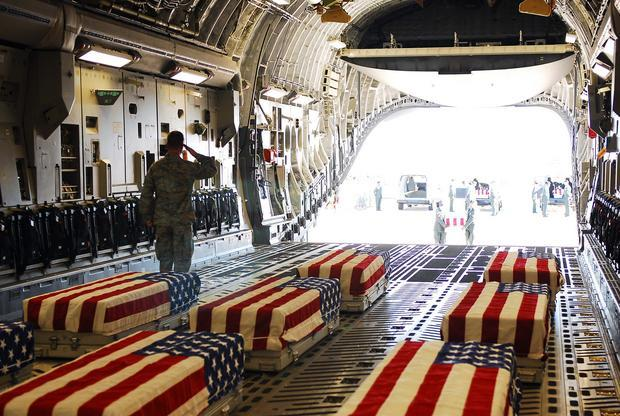 flag draped military coffins